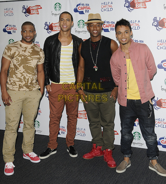 """JLS - JONATHAN """"JB"""" GILL, MARVIN HUMES, ORITSE WILLIAMS & ASTON MERRYGOLD.The Capital FM Summertime Ball, Wembley Stadium, London, England..June 12th, 2011.full length beige khaki trousers studs studded sleeveless black top print t-shirt hat black leather jacket pink shirt yellow african necklace silver .CAP/CAN.©Can Nguyen/Capital Pictures."""