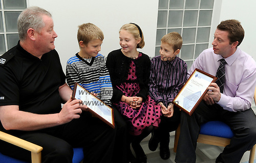 Strathclyde Police Chief Constable's Bravery Awards - Cons Colin Baird (left) and Nigel Abbott (correct spelling), who both received the Chief Constable's Commendation for their action's relating to the Biggar bus crash - here with Mr Abbott's children (l to r) Louie (8), Lilly (11) and Luke (9) - 29.10.10 - picture by Donald MacLeod - mobile 07702 319 738 - clanmacleod@btinternet.com - www.donald-macleod.com