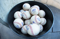 A bucket of ACC game baseballs is ready to be used during the game between the Georgetown Hoyas and the Wake Forest Demon Deacons at David F. Couch Ballpark on February 19, 2016 in Winston-Salem, North Carolina.  The Demon Deacons defeated the Hoyas 3-1.  (Brian Westerholt/Four Seam Images)