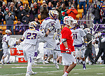 University at Albany Men's Lacrosse defeats Cornell 11-9 on Mar 4 at Casey Stadium.  Connor Fields (#5) celebrates the final goal.