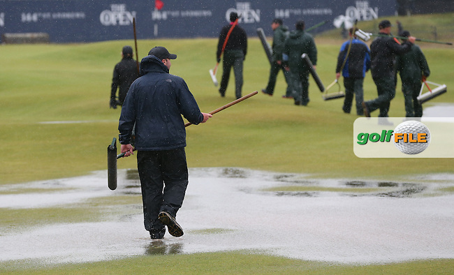 St Andrews Links ground move to the 17th green to clear the surface flooding during the postponement of play of Round Two of the 144th Open, played at the Old Course, St Andrews, Scotland. /17/07/2015/. Picture: Golffile | David Lloyd<br /> <br /> All photos usage must carry mandatory copyright credit (&copy; Golffile | David Lloyd)