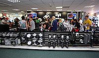 Pictured: A long queue of supporters at the club shop tills, to be the first to buy the new shirts. Saturday 21 June 2014<br />
