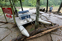 NWA Democrat-Gazette/DAVID GOTTSCHALK A pontoon paddle boat sits Friday, June 7, 2019, among trees and signage following heavy rains that caused flash flooding on Lee Creek that runs through Devil's Den State Park. Flash flooding Thursday night closed two state highways in Washington County along with a number of county roads. No injuries had been reported by this morning.