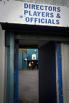 Greenock Morton 2 Stranraer 0, 21/02/2015. Cappielow Park, Greenock. A steward and an official standing inside the stadium before Greenock Morton take on Stranraer in a Scottish League One match at Cappielow Park, Greenock. The match was between the top two teams in Scotland's third tier, with Morton winning by two goals to nil. The attendance was 1,921, above average for Morton's games during the 2014-15 season so far. Photo by Colin McPherson.