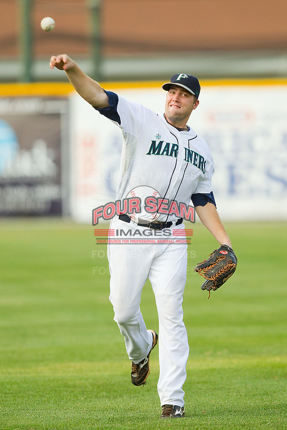 Ethan Paquette #8 of the Pulaski Mariners warms up in the outfield at Calfee Park August 29, 2010, in Pulaski, Virginia.  Photo by Brian Westerholt / Four Seam Images