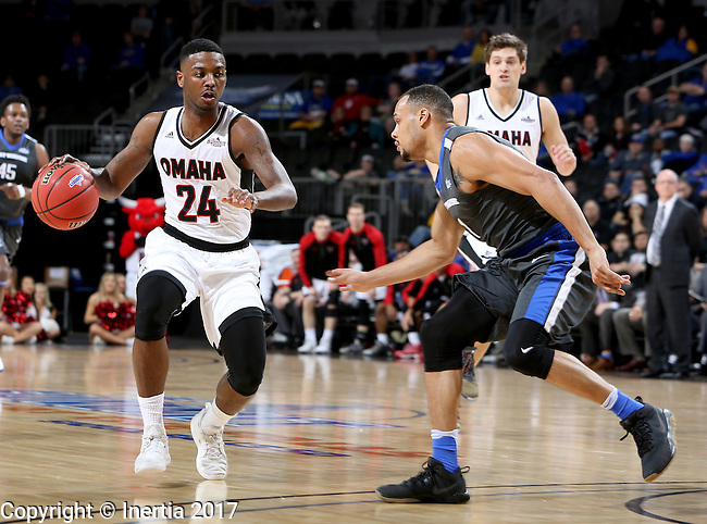 SIOUX FALLS, SD: MARCH 5: 	Tra-Deon Hollins #24 from Omaha looks to make a move past Bryson Scott #1 from Fort Wayne during the Summit League Basketball Championship on March 5, 2017 at the Denny Sanford Premier Center in Sioux Falls, SD. (Photo by Dave Eggen/Inertia)