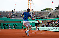 Andy Murray (GBR) (4) against Juan Ignacio Chela (ARG) in the second round of the men's singles. The match was abandoned as bad light stopped play with Murray leading 6-2 3-3..Tennis - French Open - Day 4 - Wed 26 May 2010 - Roland Garros - Paris - France..© FREY - AMN Images, 1st Floor, Barry House, 20-22 Worple Road, London. SW19 4DH - Tel: +44 (0) 208 947 0117 - contact@advantagemedianet.com - www.photoshelter.com/c/amnimages