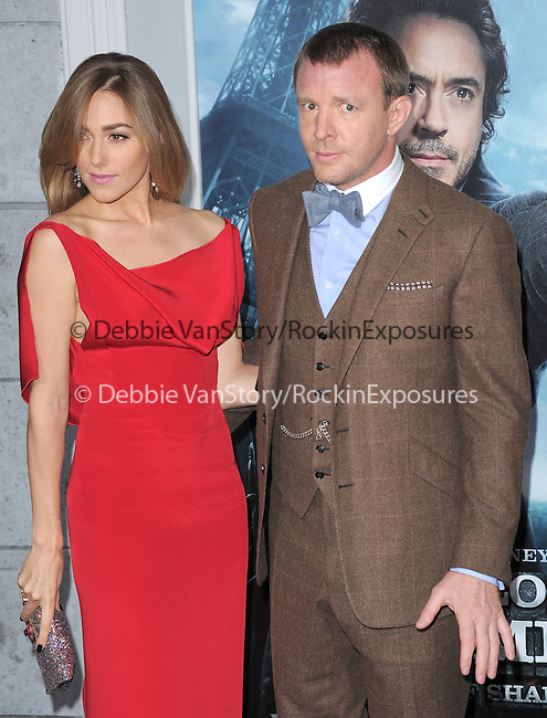 Guy Ritchie and Jacqui Ainsley at The Warner Bros. Pictures World Premiere of SHERLOCK HOLMES 2: A GAME OF SHADOWS held at The Village Theatre in Brentwood, California on December 06,2011                                                                               © 2011 Hollywood Press Agency