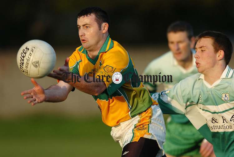 Feakles Stephen Moloney gets away from Wolfe Tones David Dunne during their Junior B Football Final at Clareabbey.Piv Arthur Ellis.
