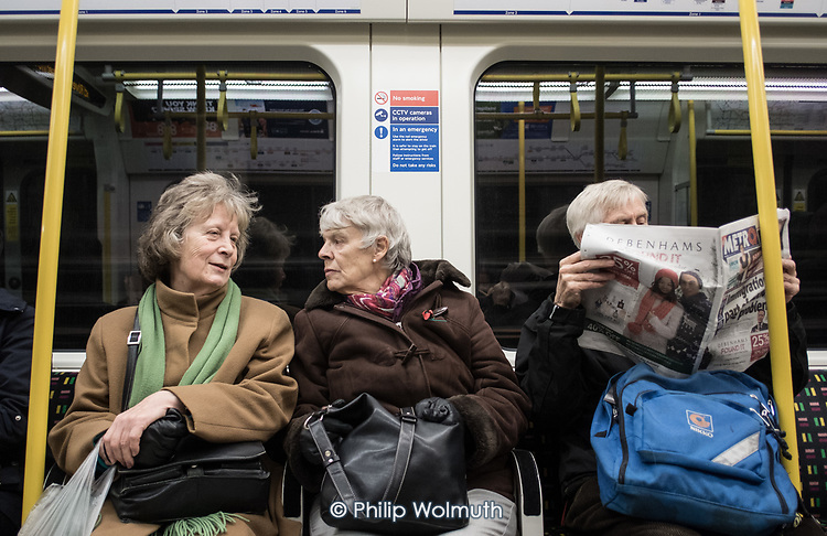 Two women passengers on the London Underground.