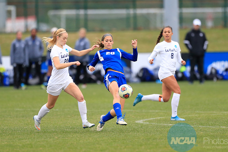 KANSAS CITY, MO - DECEMBER 03:  Becca Cates (24) of Western Washington University and Gabriella Mencotti (20) of Grand Valley State University battle for the ball during the Division II Women's Soccer Championship held at Children's Mercy Victory Field at Swope Soccer Village on December 03, 2016 in Kansas City, Missouri. Western Washington University beat Grand Valley State University 3-2 to win the national title.  (Photo by Jack Dempsey/NCAA Photos via Getty Images)