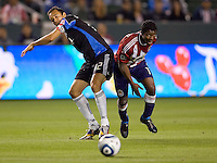 Chivas USA midfielder Michael Lahoud (11) battles San Jose Earthquakes defender Ramiro Corrales (12). CD Chivas USA defeated the San Jose Earthquakes 3-2 at Home Depot Center stadium in Carson, California on Saturday April 24, 2010.  .