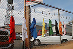 Silks hanging from the fence await the opening of Oaklawn Park on a perfect day with highs in the 70's expected . (Justin Manning/Eclipse Sportswire)
