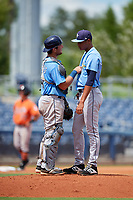 Tampa Bay Rays pitcher Luis Moncada (79) in a mound visit with catcher Erik Ostberg (41) during a Florida Instructional League game against the Baltimore Orioles on October 1, 2018 at the Charlotte Sports Park in Port Charlotte, Florida.  (Mike Janes/Four Seam Images)