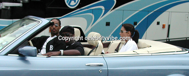 Sean Puffy Combs & Emma Heming.Bad Boy vs. Rocafella Baseball Game.To benefit disadvantaged kids.Stony Park.Easthampton, NY.July 4th, 2001.Photo by Celebrityvibe.com..