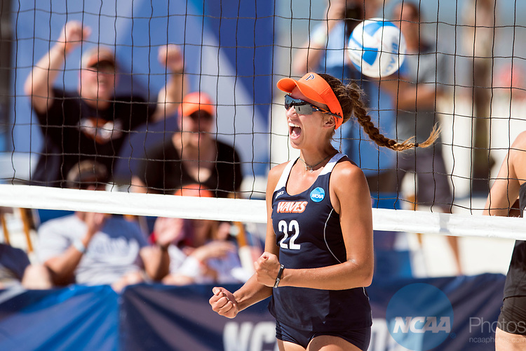 GULF SHORES, AL - MAY 07: Heidi Dyer of Pepperdine University celebrates winning a point during the Division I Women's Beach Volleyball Championship held at Gulf Place on May 7, 2017 in Gulf Shores, Alabama. Pepperdine defeated Hawaii 3-0 to advance to the championship game.  (Photo by Stephen Nowland/NCAA Photos via Getty Images)