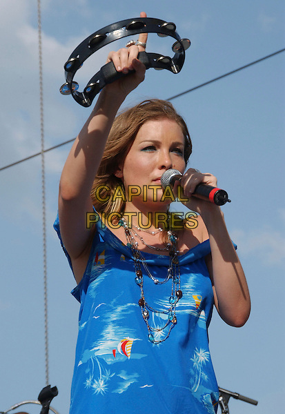 SARA BUXTON.2007 CMA Music Festival held at Greased Lightning Daytime Stage at Riverfront Park, Nashville, Tennessee, USA..June 7th, 2007 .half length stage concert live music gig performance blue dress singing tambourine.CAP/ADM/LF.©Laura Farr/AdMedia/Capital Pictures