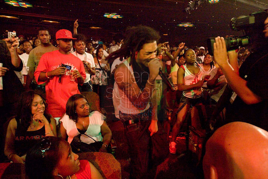 Gunplay in the crowd as Rick Ross performs during the Boost Mobile RockCorps concert at The Fox Theatre in Atlanta on Saturday, June 9, 2007.