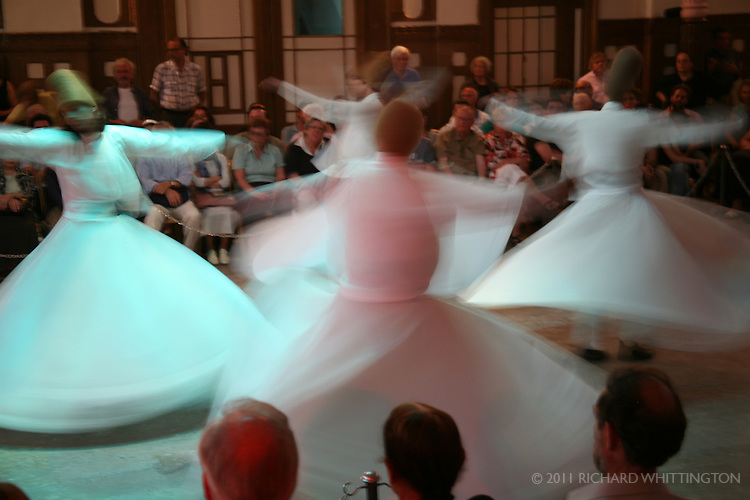 Whirling is the climax of the sema, an Islamic ritual that represents their submission to God. The dervishes' open arms allow divine energy to enter their body.