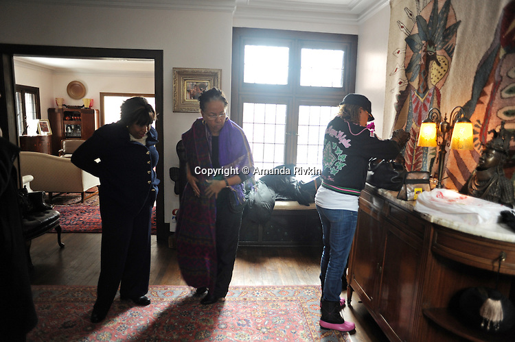 (Left) Candidate Carol Moseley Braun, a former U.S. Senator and Ambassador to New Zealand, is seen with friends and campaign workers in the foyer of her Hyde Park home before going to cast her ballot in the Chicago mayoral elections in Chicago, Illinois on February 22, 2011.