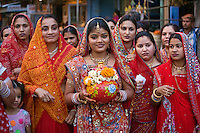 Rajasthani women carry a clay pot through the city as part of the GANGUR FESTIVAL in JOHDPUR - RAJASTHAN, INDIA