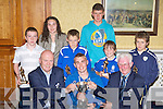 Tom Tobin (left) and Don O'Donoghue presents Stephen Cahillane the player of the year cup at the Killarney Athletic juveniles ceremony in the Dromhall Hotel on Friday night in the back row are the other award winners on the night l-r: Danny Healy, Aisling Clifford, Gavin White, Jack O'Connor, Ciara Randles and Shane O'Connor