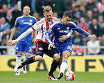 Jan Kirchhof of Sunderland tackles Eden Hazard of Chelsea during the Barclays Premier League match at the Stadium of Light, Sunderland. Photo credit should read: Simon Bellis/Sportimage