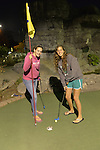 Freeport, New York, U.S. September 6, 2013. Cousins ALIYA SIDER, 15, in pink top, and BRITTNEY SCANNELL, 17, in gray top, both from Baldwin, play a night game of miniature golf at Crow's Nest Mini Golf at the Nautical .
