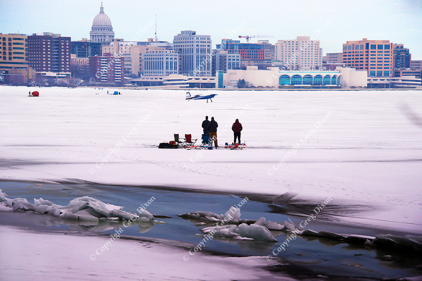 People fly model planes on frozen Lake Monona, in view of Madison's State Capitol building and Monona Terrace on Saturday | Digital Photograph with Oil Painting Effect