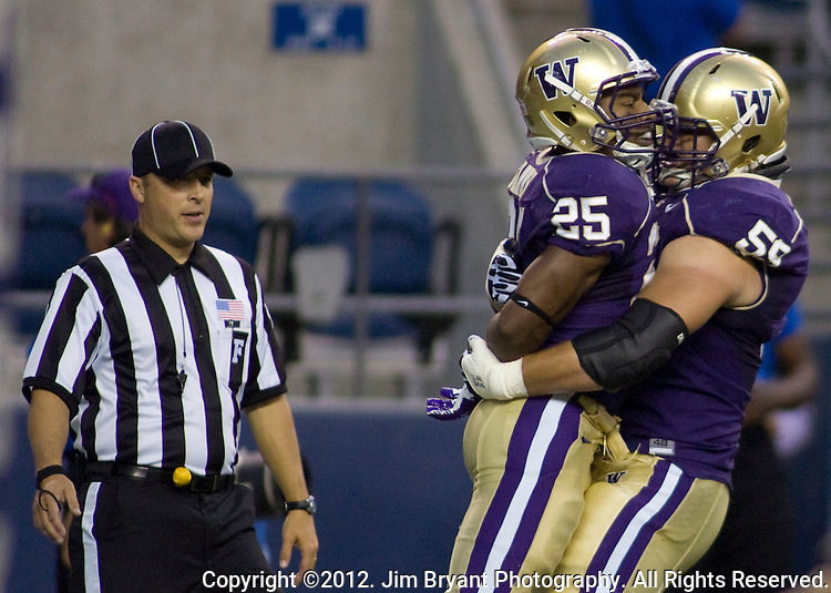 Washington's 'running back Bishop Sankey is hugged by teammate Ben Riva after scoring a touchdown against San Diego State in a college football game at CenturyLink Field in Seattle, Washington on September 1, 2012  The Huskies beat the Aztecs 21-12.  © 2012. Jim Bryant Photo. All Rights Reserved.