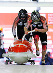 18 December 2010: Heath Spence starts up his 2-man bobsled for Australia, finishing in 16th place at the Viessmann FIBT World Cup Bobsled Championships on Mount Van Hoevenberg in Lake Placid, New York, USA. Mandatory Credit: Ed Wolfstein Photo