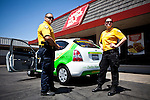 """Delta Hawkeye Security guards Travis Teel, left, and Cortnie Talbot, right, patrol the """"Miracle Mile"""" business district in Stockton, Calif., July 11, 2012. The bankrupt city has cut back on many services, while residents and private contractors are picking up the slack."""