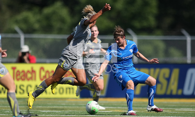 Lianne Sanderson (10) of Philadelphia  goes airborne after a tackle by Boston's center back, Amy LePeilbet (6).  The Boston Breakers scored two goals in the second half to pull out a 2-1 victory over the Philadelphia Independence at John A Farrell Stadium in West Chester, PA.
