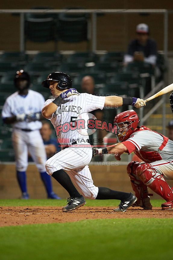 Salt River Rafters catcher Chris Rabago (5) at bat in front of catcher Andrew Knapp (8) during an Arizona Fall League game against the Glendale Desert Dogs on October 23, 2015 at Salt River Fields at Talking Stick in Scottsdale, Arizona.  Glendale defeated Salt River 7-5.  (Mike Janes/Four Seam Images)