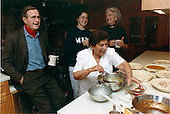 Camp David, Maryland - November 23, 1989 -- United States President George H.W. Bush shares drink with his daughter, Dorothy, and first lady Barbara Bush in the kitchen at Camp David, Maryland on November 23, 1989 as Thanksgiving Dinner is being prepared.  The lady preparing the meal is unidentified..Credit: White House via CNP