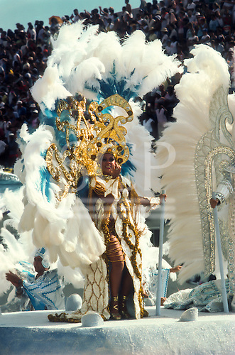 Rio de Janeiro, Brazil. Samba school; carnival queen on a float during the parade through the sambadrome with white and touquoise feather headdress.