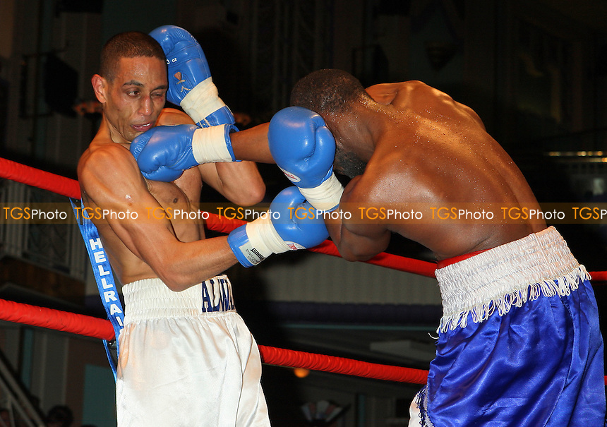 Wayne Alwan-Arab (Hackney, white shorts) defeats Jason Nesbitt (Birmingham, white/blue shorts) in a Middleweight boxing contest at the Troxy, Limehouse, London, promoted by Mickey Helliet / Mayfair Sporting Club - 05/03/09 - MANDATORY CREDIT: Gavin Ellis/TGSPHOTO - Self billing applies where appropriate - 0845 094 6026 - contact@tgsphoto.co.uk - NO UNPAID USE.
