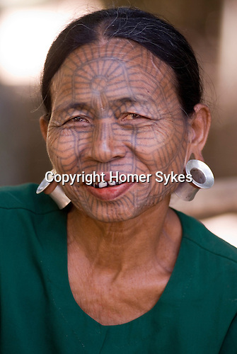 PANMYAUNG VILLAGE,  Myanmar (Burma) 2008.Chin tribal women with tatooed faces.