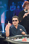 """Miami"" John Cernuto shows his pocket aces to the crowd as he makes a call.  He then counts down the number of outs Adam Weinraub has.  He had pocket queens."