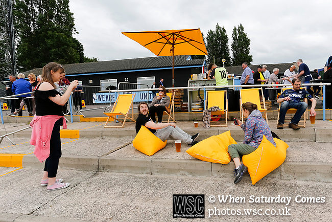Fans enjoying the outdoor bar area. Yorkshire v Parishes of Jersey, CONIFA Heritage Cup, Ingfield Stadium, Ossett. Yorkshire's first competitive game. The Yorkshire International Football Association was formed in 2017 and accepted by CONIFA in 2018. Their first competative fixture saw them host Parishes of Jersey in the Heritage Cup at Ingfield stadium in Ossett. Yorkshire won 1-0 with a 93 minute goal in front of 521 people. Photo by Paul Thompson