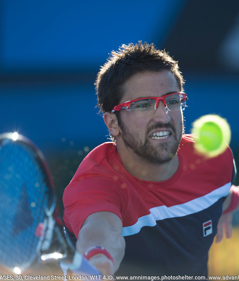 Yanko Tipsarevic..Tennis - Australian Open - Grand Slam -  Melbourne Park  2013 -  Melbourne - Australia - Wednesday 16th January  2013. .© AMN Images, 30, Cleveland Street, London, W1T 4JD.Tel - +44 20 7907 6387.mfrey@advantagemedianet.com.www.amnimages.photoshelter.com.www.advantagemedianet.com.www.tennishead.net