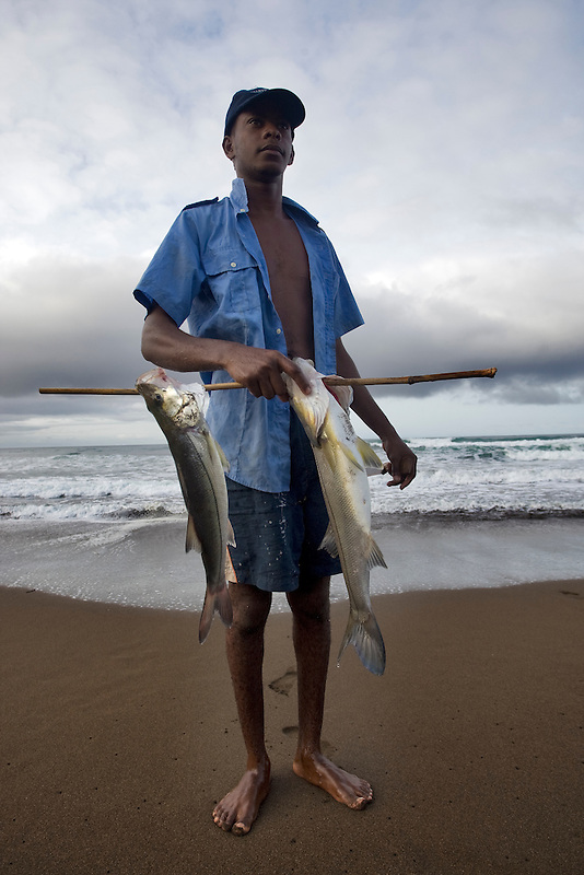 Fisherman proudly shows his catch. Jaque, Panama