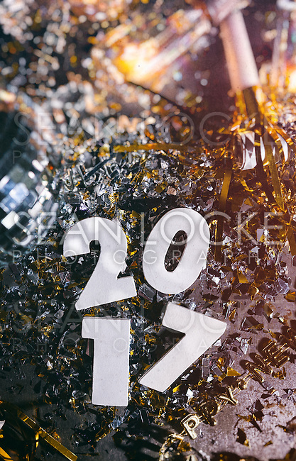"Gritty images featuring ""2017"" with decorations, confetti, and more.  Space for copy."