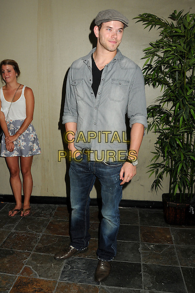 "KELLAN LUTZ.Matt Leinart's 4th Annual ""Bowling With The Stars"" Event held at Lucky Strike Lanes, Hollywood, California, USA..July 15th, 2010.full length hand in pocket shirt grey gray jeans denim flat cap hat.CAP/ADM/BP.©Byron Purvis/AdMedia/Capital Pictures."