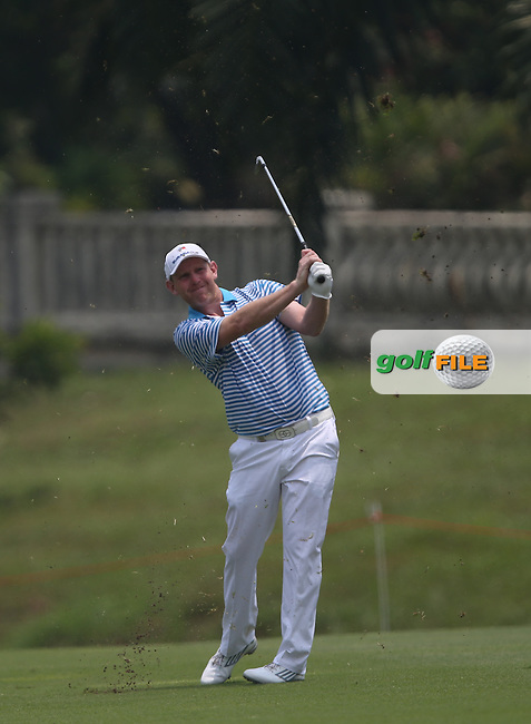 Team Europe's Stephen Gallacher (SCO) plays second shot to the 13th during the second day Foursome matches at the 2014 EurAsia Cup presented by DRB-Hicom, at the Glenmarie Golf & Country Club, Kuala Lumpur, Malaysia. Picture:  David Lloyd / www.golffile.ie