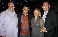 NWA Democrat-Gazette/CARIN SCHOPPMEYER Steve Wood (from left), Tom Pagnozzi and Marie-Laure(cq) and Ian Rowland visit at the Pagnozzi Charities Ultimate Tailgate benefit Oct. 2 at the Fayetteville Town Center.