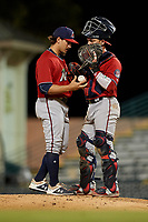 Fort Myers Miracle relief pitcher Tom Hackimer (17) talks with catcher Ben Rortvedt (15) during a Florida State League game against the Bradenton Marauders on April 23, 2019 at LECOM Park in Bradenton, Florida.  Fort Myers defeated Bradenton 2-1.  (Mike Janes/Four Seam Images)