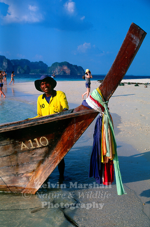 Longtail boat captain. Waiting for a fare to return to the mainland. Ko Poda (Krabi province) - Thailand.