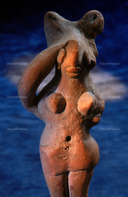 Female figurine from Harappa dated to around 2450 BC.  Catalog number 136. ..4,800 years ago, at the same time as the early civilizations of Mesopotamia and Egypt, great cities arose along the flood plains of the Indus and Saraswati (Ghaggar-Hakra) rivers.  Developments at Harappa have pushed the dates back 200 years for this civilization, proving once and for all, that this civilization was not just an offshoot of Mesopotamia..They were a highly organized and very successful civilization.  They built some of the world's first planned cities, created one of the world's first written languages and thrived in an area twice as large as Egypt or Mesopotamia for 900 years (1500 settlements spread over 280,000 square miles on the subcontinent)..There are three major communities--Harappa, Mohenjo Daro, and Dholavira. The town of Harappa flourished during this period because of it's location at the convergence of several trade routes that spanned a 1040 KM swath from the northern mountains to the coast.