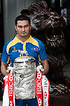 International rugby player Timur Mashurov of Kazakhstan from the Top 5 nations competing in this year's HSBC Asian 5 Nations poses with the tournament trophy near the iconic HSBC lion on January 19, 2011 in Hong Kong, China. Japan is the defending champions. Photo by Victor Fraile